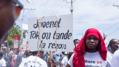manifestan sign Jovenel credit openDemocracy