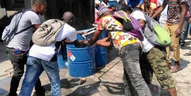 Haiti.workers sanitizing hands.COVID .3.20.Reginald Lafontant 1 615x310 credit Solidarity Center 1